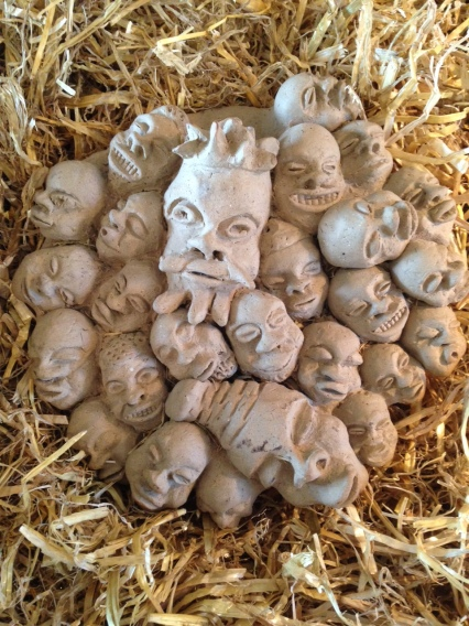 A jumble of heads... but whose are they? Why are two bigger than the others? What are they saying to one another, and why?